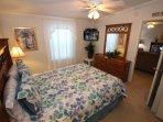 Queen master bedroom with flat screen TV