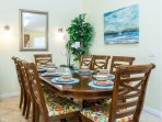 Dining for 6, plus 6 more in the kitchen and 4 stools