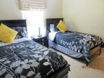 Bedroom with a twin and a full size bed