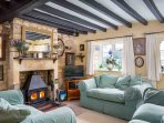 The cosy, characterful living room, with a roaring log burner