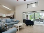 Living room with sliding doors open to outside lanai.