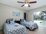 Third bedroom (2 twin beds) with sliding doors open to lanai.