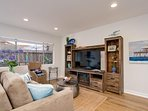 San Clemente vacation rental living room entertainment center includes an HD TV and gas fireplace.