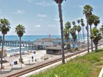 San Clemente beach pier with restaurants and shops.