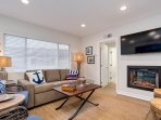 With an HD TV and cozy fireplace, this living room is the perfect place to relax after a long day at the beach.
