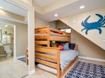 Third bedroom includes twin and full bunks and private bathroom.