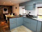 Kitchen open plan to dining area with tv and radio