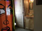 reclaimed wood & claw foot tub in bathroom
