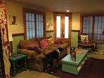 living room full of lush fabrics & vibrant colors