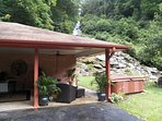 Just off the outdoor patio, exposed to the stars and a perfect view of your waterfall you will find the hot tub.