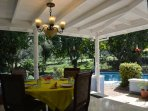 Pool side patio offers a lovely place to eat breakfast and enjoy some fresh brewed coffee