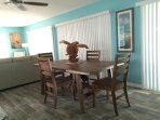 Dining area provides comfortable seating for eating or a game of cards.