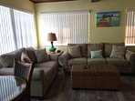Living area with 50' Smart T.V., and queen pull-out Tempur-Pedic mattress.