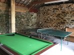 Games room with table tennis and pool table.