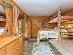guest bedroom with queen lower and twin upper bunk
