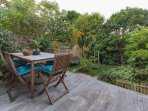 Leafy garden and dining deck