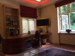 • In the living room you have a large desk with cabled internet. Wall mounted wide screen TV