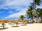 Los Corales Beach equipped with chairs and umbrellas