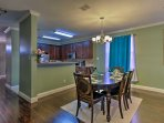 Host your formal meals at the 6-person dining table.