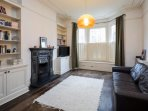 The living area is spacious and inviting with lovely wooden floors and large...
