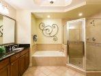 The en-suite bathroom boasts a a deep soaking tub for relaxing bubble baths.
