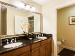 Wash off with ease using the double-sink vanity.