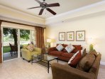 The living room includes tasteful decor, comfortable furnishings and a flat-screen TV for those nights at home.