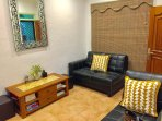 Cosy lounge with 2 x 2 seater sofas,TV,Video,Cable TV channels,ceiling fan and aircon.