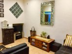 Cosy loung with cable TV, DVD, 2 x 2 seater sofas, coffee table, book library,