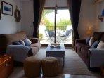 living room leading onto balcony, over looking Marina