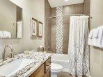 Great full size upper level bathroom with custom stone.