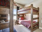 Beautiful bunk room with additional lower futon seating.