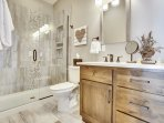 Fantastic custom master bathroom with a large stone shower.