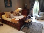 The ultra glamorous bedroom with superb furnishings and on-suite bathroom