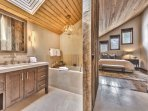 Grand Master Bathroom with Dual Sinks, Sky Lights, Soaking Tub, and Large Stone Shower