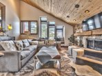 Upper Level Living Room with Cozy Mountain Contemporary Furnishings, a Smart TV and a Gas Assist Wood Fireplace