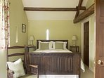 Another view of the Master Bedroom with an antique linen fold carved king size bed