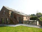 Elk Cottage rear gated terrace and open plan gardens