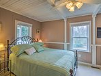 Two guests will sleep soundly in the master bedroom's queen bed.