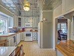 The wonderful kitchen has an original tin ceiling.