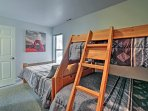 A full bed and twin-over-full bunk bed completes the room.