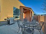 Use the gas grill to make a barbecue feast and enjoy your meal at the outdoor dining table.