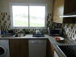 kitchen with microwave dishwasher and washing machine