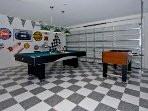The Games Room has a Pool Table, Foos Ball, and Darts.It is decorated in Auto Mobile memmorabelia.