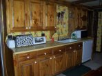 Custom hand made cabinetry with country theme.