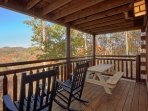 Main level deck with picnic tables (2) and rocking chairs
