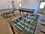 Game room featuring Foosball, Ping-pong and a pool table.