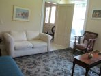 Relax with friends and family in the living room at Swim House