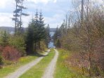 Enjoy a short walk down a country lane to the rocky shoreline with sandy beach