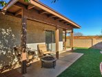 Boasting a synthetic lawn, fire pit, and patio furniture, the backyard is sure to be a centerpiece of your stay.